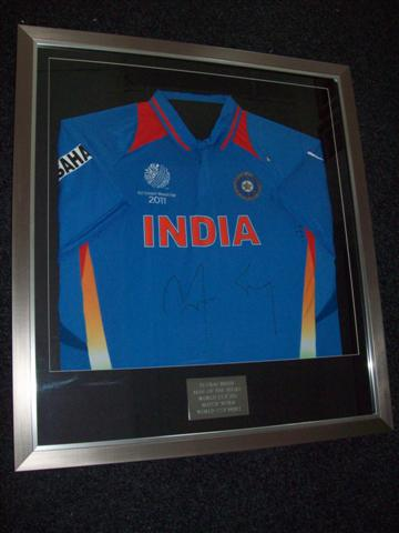 your shirt framed in your choice of frame with plaque plaque supplied by us